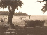 The green and beach circa 1920