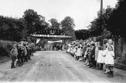Wedding 1907, children lining New Road with banner over Long Life and Happiness