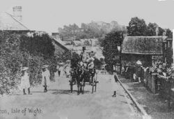 Carriage coming up the High Street circa 1920