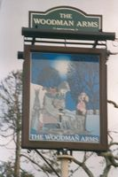 The Woodman Arms sign